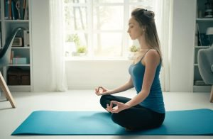 Woman Doing Yoga Practicing Mindfulness Meditation to Improve Coping Skills