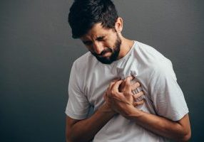 The Link Between Depression and Heart Disease - Man Grabbing His Chest In Pain